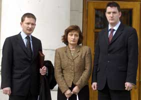 The family of murdered solicitor Pat Finucane wife Geraldine with sons Michael and John