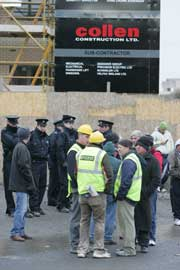 • A line of Gardai secure the entrance of the Collen building site in UCD, as supporter of the Ballybrack Three Andrew Clare, Billy McClurg and Keith Kelly protest outside the site, 22 February 2006