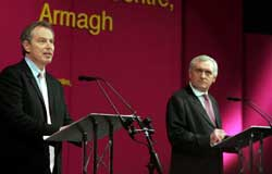 British Prime Minister Tony Blair and Taoiseach Bertie Ahern speaking during a press conference in the Navan Centre, in Armagh