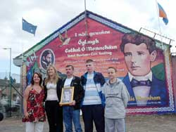 Laura McAree, Mayor of Kerry Toireasa Ní Fhearaoisa, Liam McAree, Terry and Frank McKenna at the newly painted mural in memory of Charlie Monahan on Mountpottinger Road
