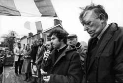 Fr Brian McCreesh (brother of hunger striker Raymond)  addressing an anti-H Block/Armagh rally. Sinn Féin Councillor John Davey (assassinated by loyalists in 1989) on the extreme right of picture