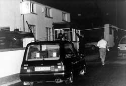 A hearse arrives at O'Tooles bar, Loughlinisland, in preparation for the removal of the bodies, 19 June 1994