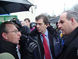 British Minister David Hanson is confronted by Sinn Féin MLA Michael Ferguson over cuts to community funding, while on a visit to the greater Colin area in West Belfast