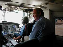 Martin McGuinness travelling by military helicopter from Colombo to the Tamil area