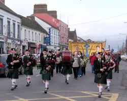 The parade was led by a colour party and Piobaira Uladh Pipe Band