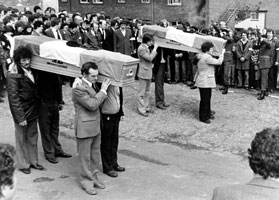 IRA Volunteers in full uniform fired a volley over the coffins of their comrades Volunteers Willie Fleming and Danny Doherty