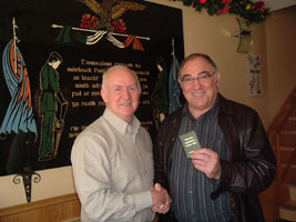 Liam Shannon presents Ronnie Kasrils with his Honorary membership of the Felons Association on Tuesday 5 December