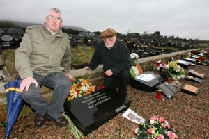 Padraig McCotter of the Belfast National Graves Association and Martin Meehan look at the desecrated graves after the attack on the Republican Plot at Milltown Cemetery