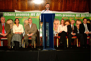 Gerry Adams told the packed Dublin meeting that Sinn Féin should be judged on the changes it brings about