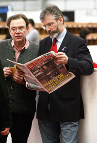 Tom Hartley and Gerry Adams keep informed with a copy of An Phoblacht