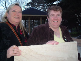 Sinead Moore and Sue Ramsey MLA with an engraved sandstone paving stone donated for the new Women's Memorial Garden being built in Belfast by Macalla na mBan in memory of women who dedicated their lives to the struggle for Irish freedom