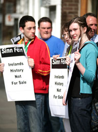 Sinn Féin members are pictured at the protest outside the offices of James Adams Auctioneers