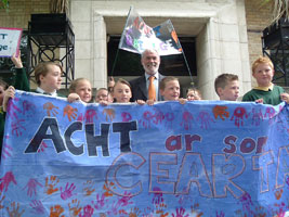 Francie Brolly with kids from Gaelscoil na Mona protesting at the BBC in Belfast on Tuesday, 5 June, over the state-run broadcaster's lack of coverage of Irish language issues