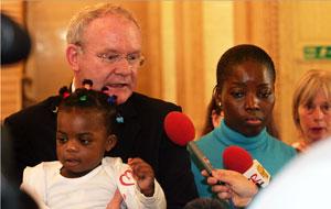 Martin McGuinness with Lordorice Djountsu and her daughter Imelda