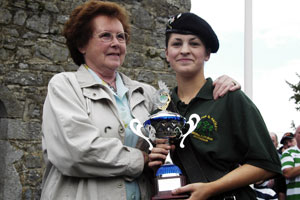 The Fergal Caraher Trophy, named in honour of the young man gunned down by British soldiers at Cullyhanna in 1990 was presented by Fergal's mother Mary to band member Aoife Comiskey