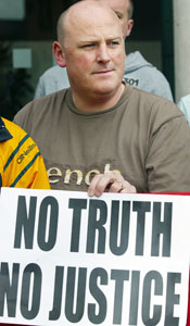 Mark Sykes who was injured in the Sean Graham bookmakers shooting on the Ormeau Road in February 1992, pictured at the anti collusion protest outside court in Belfast, Monday 2 July 2007