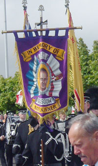 The banner honouring UVF gunman Noel Kinner carried by members of the Scottish Sons of Ulster Flute Band at the Orange Order's Whiterock parade