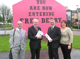 David McCartney, Seán Martin and Ruth Noonan of the Rainbow Project with Deputy First Minister, Sinn Féin's Martin McGuinness at Free Derry Corner, which has been painted pink for the occasion, as part of events to launch the Foyle Pride Fes