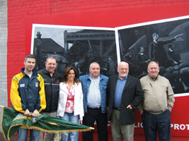 At the mural launch: Steven Corr, Lisa Moody and Gerry McConville of Falls Community Council and Martin Meehan, Danny Lavery, Fra McCann and Liam McBroin of the Sinn Féin Trade Union Department Belfast.