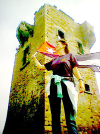 Eleanor Lanigan of Free The Miami Five Campaign flies the flag at Glen Head during the annual Camp Havana 2007 gathering at Gleann Cholm Cille, Donegal