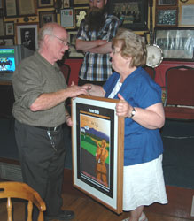 Nóirin Sheridan presenting Peter Daly's relative and namesake, Peter Daly will special edition framed commemorative poster signed by Bob Doyle