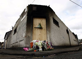 Bray fire — Flowers laid at the site of the factory fire which claimed the lives of two firefighters