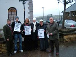 Sinn Féin TD Arthur Morgan and Councillor Martin Hallinan join local Sinn Féin member demanding job creation in Youghal during the Dáil fact-finding mission