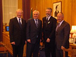 The North's Deputy First Minister Martin McGuinneess, Taoiseach Bertie Ahern, Sinn Féin President Gerry Adams and Minister Dermot Ahern at the meeting on Monday