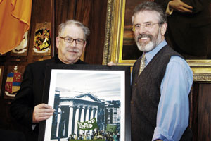 Gerry Adams being presented with one of the Robert Ballagh's prints by the artist
