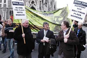 Sinn Féin Councillors Larry O'Toole and Dessie Ellis with Arthur Morgan TD (centre) show solidarity with the Plaza workers