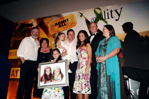 PRESENTATION: Gerry Adams with his wife Collette, granddaughter Drithle, son Gearóid holding another granddaughter Luisne, Gearóid's wife Róisín, Bobby Storey and Michelle Gildernew