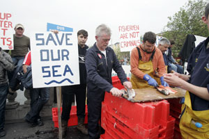Fishermen from Kilmore Quay, Wexford, give away fish on Dublin's O'Connell Bridge in protest at the Government's failure to support their industry