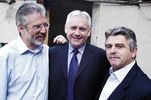 SUPPORT: Sinn Féin President Gerry Adams and Arthur Morgan TD with Brendan McFarlane before he appeared in court on Tuesday. His trial opened the following day