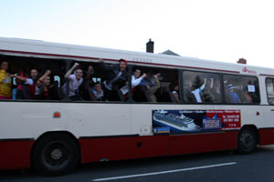 WINDOW OF HATE: Loyalists (who have put the windows out of their own bus) jeer and abuse nationalists as they are bussed past Ardoyne