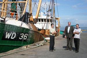 Sinn Féin Councillor Maurice Roche with fishermen Mark Fethersonhaugh (left) and Mark Cullen