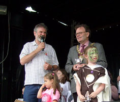 Gerry Adams and Tom Hartley with  young Celts at the opening day of Féile