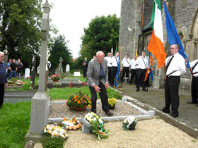 Oliver Brady, a nephew of James Crossan, lays a wreath on the grave