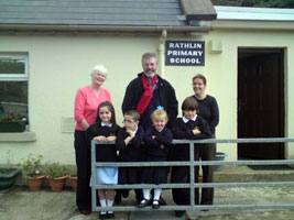 Gerry Adams with teachers and pupils at Rathlin Primary school