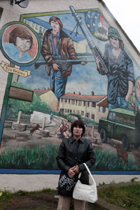 THE BOYS FROM BALLYMURPHY: Patrick Mulvenna's widow Frances at the commemorative mural for Patrick and his comrade Jim Bryson