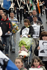 REMEMBRANCE: People in the parade carried portraits of local republican dead