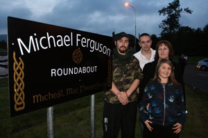 Michael Ferguson's partner Louise, sons Hugh and Daibhibd and daughter Niamh at the newly renamed roundabout in Poleglass