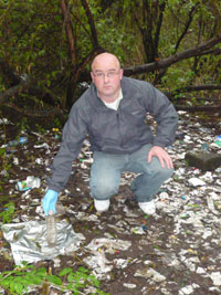 DANGEROUS: Robert Ballesty amidst the drugs debris littering the park where children play