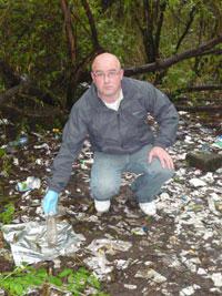 DANGEROUS: Robert Ballesty amidst the drugs debris littering the park where children play