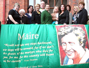 WOMEN OF THE WORLD: Conference delegates stand behind a banner honouring Sinn Féin Vice-President Máire Drumm, assassinated by a unionist death squad in her Mater Hospital bed in 1976