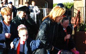 HOLY CROSS: Schoolgirls are terrorised by unionist mobs