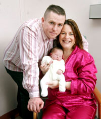 HAPPY FAMILY: Michelle with husband Jimmy and baby Aoise