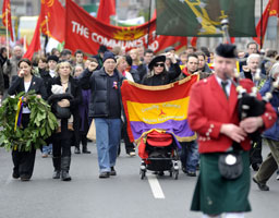 COMRADES COME RALLY: Bob Doyle's ashes and the flag of the International Brigades lead a parade of several hundred down O'Connell Street