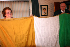 THE FLAG: Mary and PJ with the Tricolour that draped the coffin of Volunteer Michael McVerry