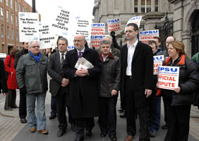 STANDING FIRM: Sinn Féin Oireachtas members stand with the public sector workers