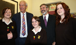 St Louise's pupils Laura Whinney, Sally Smyth and Nuala Lunney with Sinn Féin president Gerry Adams and veteran broadcaster Jon Snow